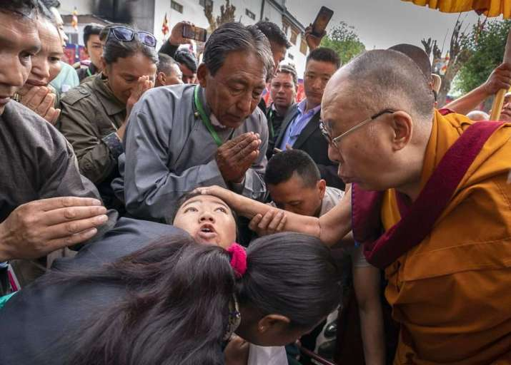 The Dalai Lama comforts a young woman on his way to the Leh Jokhang on Wednesday. Photo by Tenzin Choejor. From dalailama.com
